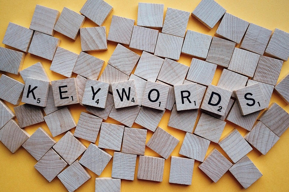 SEO content writing involves keyword research (image of keywords spelled in scrabble tiles)